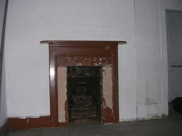 Photo:Metal work stolen from the fireplace.