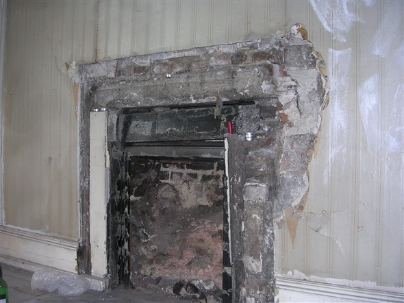 Photo:Missing fireplace.