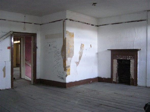 Photo:Top floor room where fireplaces have been removed, September 2009.